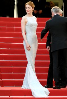 Best Dressed: Emma Stone in Christian Dior Couture long train white gown at the red carpet during Cannes Film Festival 2015. #Cannes #Cannes2015
