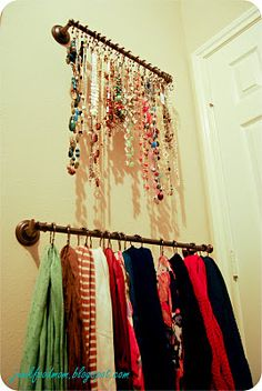 Closet organization: Necklace and scarf storage - towel bars with shower hooks-really love this idea! Could put on the inside of the closet door
