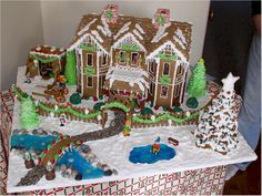 Betty Arms is at it again, creating this stunning Trivilian Gingerbread House and wonderful gingerbread display. Pattern is available at www.ultimategingerbread.com.