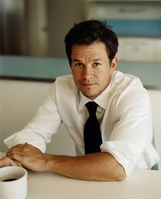 Mark Wahlberg .... I wouldn't mind having my morning coffee with him ;)