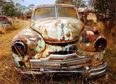 Old rusty car. Amazing surface study, and wonderful colours