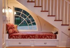 Charming built in seating below the traditional staircase by Jon R. Sayler, Architect AIA PS