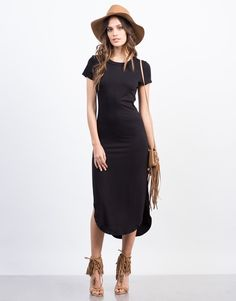 This black Simple Midi Dress is a dream come true for those lazy days. Pair this midi dress with some white sneakers for a casual, chic day out.