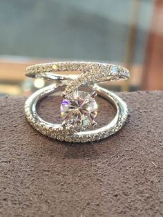 Custom Gabriel & Co design with round #diamond center and amazing #pave band
