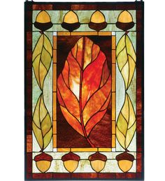 Harvest Festival Window | This stained-glass panel is inspired by the cozy colors and natural elements found at harvest time. Glass artisans use precision-cut pieces of honey-gold, autumn-green, and lush, brown-toned glass to fashion an eye-catching motif of fall-season russet leaves and ripened acorns | Stained glass