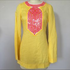 Tory Burch yellow and pink tunic size 0 Like new! No signs of wear! Beautiful cheerful yellow color! Long sleeve lightweight fabric. 100% cotton. Pink and orange sequins on front and around neckline. Zipper closure in back. Size 0. No trades please. Tory Burch Tops Tunics