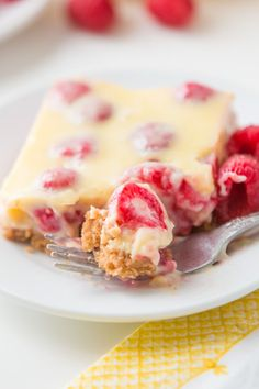 This is the number one most requested dessert by all of our friends and family, Lemon Raspberry Bars with a buttery graham cracker crust! ohsweetbasil.com