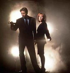Mulder and Scully. John Doggett, Monica Reyes, Annabeth Gish, David And Gillian, Laurie Holden, Ghost Movies, Fbi Special Agent, Chris Carter, Dana Scully