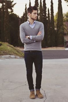 Grey V-neck sweater, blue oxford, dark jeans (rolled), desert boots, watch; fit is everything; thisisnotnew.com