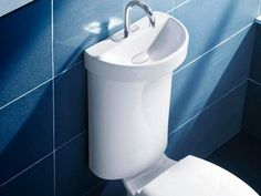 Dual Flush Toilet with Integrated Sink!