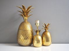 Lovely vintage brass pineapple lamp, perfect for any room in the house. Overall, this piece is in great working condition with just the right patina. The cord 100% intact and re-wiring would not be necessary. The finish is shiny and this piece displays beautifully. Requires a 60 watt bulb. Total height = 10 1/2 tall and the pineapple measures 6 3/4 tall. The cord measures 5 long. ***This listing is for the larger lamp in the first photo only (medium sized in the final photo).***  Find lots…