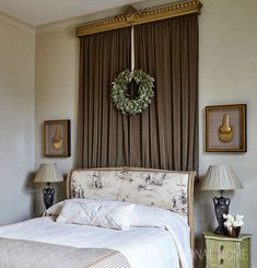 A velvet panel hung behind the upholstered headboard adds warmth and texture to the guest room. - Photo: Jean Allsopp / Design: Melanie Pounds