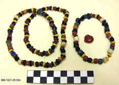 Beads, 206 glass beads and one amber bead found at a gravesite in 1927. Late Iron age, Fjære, Solum, Skien, Telemark, Norway. (Telemark Museum)