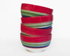 30% discount in set of 4 handmade ceramic bowls     Red, green and blue striped pattern hand-painted bowl set