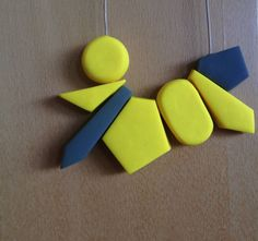 Grey and Vibrant Yellow Geometric Polymer Clay Necklace. $35.00, via Etsy.