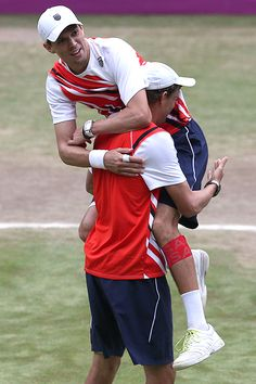 Bob and Mike Bryan celebrate after winning gold against France in men's tennis doubles.