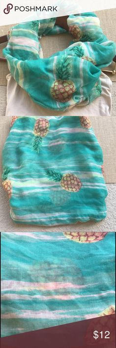 {pineapple & aqua} lightweight scarf/wrap This ultra lightweight scarf is the perfect addition to your summer closet. Extra large to add fun color and pattern to a basic tee or try it wrapped around over a swimsuit by the pool! Minor picking as shown- but not noticeable when worn. Accessories Scarves & Wraps