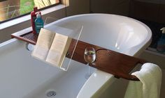 Bath caddy with book and wine glass holder made from brown Kiaat and Perspex.