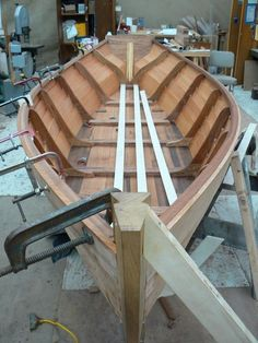 Boat being build. http://www.woodworkblueprints.com/plans/boats.html