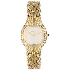 PATEK PHILIPPE Lady's Yellow Gold and Diamond La Flamme Watch Ref 4815/3J