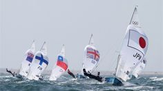 Ryunosuke Harada and Yugo Yoshida of Japan speed downwind, spinnaker up, in the men's 470 Sailing on Day 8. The Japanese pair were in 15th place overall after six races at Weymouth and Portland.