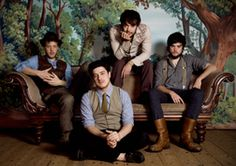 Mumford & Sons are an indie folk/bluegrass group formed in London in December2007. The band consists of Marcus Mumford (lead vocals, guitar, bass drum), Country Winston (banjo, slide guitar, vocals), Ted Dwane (double bass, drums, vocals), and Ben Lovett (keyboards, accordion, vocals).
