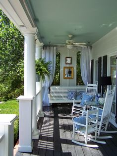 Love the shutters/artwork and drape idea on the end of the porch