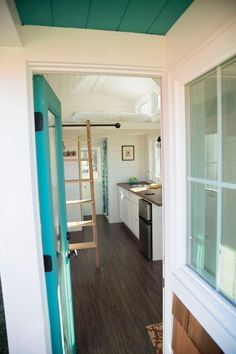 I absolutely love the feel of this tiny house.  Very close to what I envision for ours in the colors and textures!
