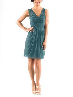 DescriptionJenny Yoo AdelleCocktail length bridesmaid dressIllusion V-neckline with deep V-backNatural waistlineSoft Tulle
