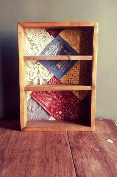 Line shelves with repurposed tin tiles