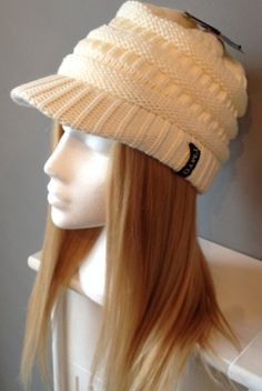 Chemo hat with human hair by Headshigh on Etsy, £99.99