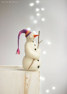 This little felted Snowman was born in Sofia a few days ago, although there is no snow yet. She is made of wool and has a long purpule nightcap.  For my Dreamy White Snowman I used felt needle techniques and 100% pure Bulgarian wool. I dye the wool myself to achieve the right colors.  This White Snowman will make you feel surrounded by love. Just put him around or give her as a present to a friend or family member. Treat her with care and he will fill you with love and holiday spirit.  Size…