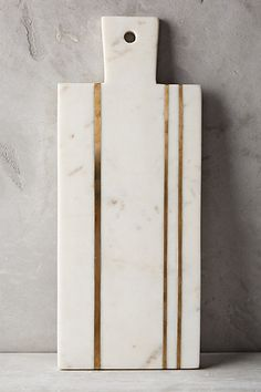 Brass Inlay Cheese Board #anthropologie, this would be a really nice way to have seems on a marble counter top.