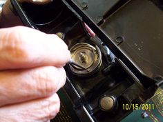 My Sewing Machine Obsession: Singer 221: How to remove the bobbin case