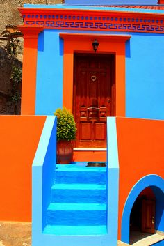 Closeup view of an orange and blue traditional house, Chorio, Symi island, Dodecanese, Greece
