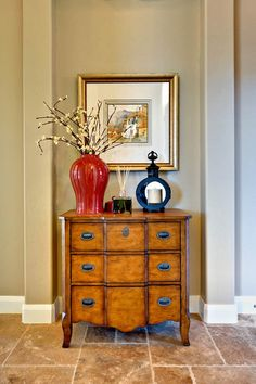 like the idea of a bold color spot with tall branches for entry hall
