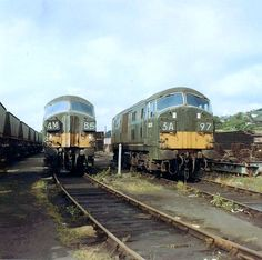 D6330 and another unidentified Class 22 at Plymouth Laira sometime in 1968-69. Built by the North British Locomotive Company in Glasgow and delivered on 23rd July 1960. Initially withdrawn in Oct 1968 but after a year in store at Laira, was reinstated in Sept 1969. Finally withdrawn on 23rd Sept 1971 and cut up at Swindon Works in June 1972. (Fred Castor)