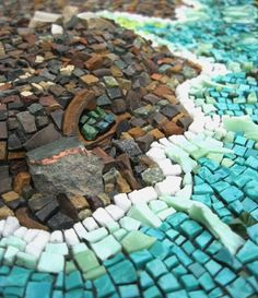 I can so totally see the waves working against the beach.  Well done.  Rachel Sager Mosaics