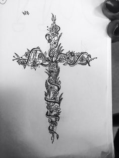 A cross tattoo done by Madison Metivier  #Tattoo #Floral #Cross