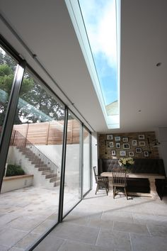 Love the flow of the floor from house into garden. Minimal Windows along a rear extension with walk-on rooflight to the balcony above. Roof Skylight, Roof Window, Skylights, Skylight Blinds, Glass Extension, Roof Extension, Architecture Details, Interior Architecture, Interior And Exterior
