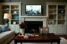 Favorite Paint Colors: family room/living room (Quiver Tan by Sherwin Williams). Also loving the built-ins.