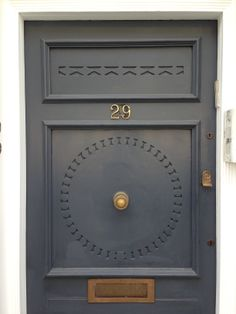 An imposing black paneled Georgian front door \'Number 1\' with ...