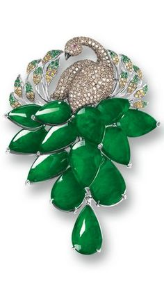 Jadeite, Gemstone and Diamond 'Peacock' Brooch Modelled as a peacock pavé-set with circular-cut green and brown sapphires, yellow diamond and rubies together weighing approximately 2.05 carats, the plumage set with thirteen translucent jadeite plaques of emerald green colour, mounted in 18 karat white gold.