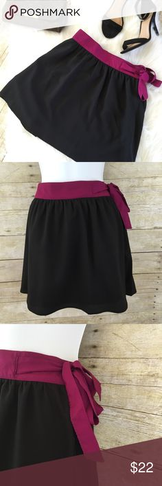 "NWT Black Flare Skirt New black skirt with purple/Wine color waist line. Ties in the the side with a zipper.   Details: 💜Size XL juniors 💜Waist: 16.5"" across laying flat 💜Length: 17"" measured laying flat 💜100% Polyester Joe Benbasset Skirts"