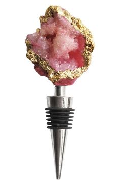 Multifaceted, crystallized agate adds stunning sparkle to this eye-catching metal wine stopper.