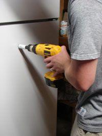 Converting a fridge into a Kegerator.