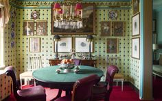 Room of the Day - breakfast room in his New York home, Jeffrey Bilhuber chose Mauny's French 19th-century block-print pattern wallpaper and a table topped with green billiard cloth.