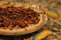 Butterfinger Pie - this easy, no-bake recipe only requires 4 ingredients, but it's always a crowd-pleaser! Love the sweet filling with bits of crunchy Butterfinger. Mmmmm
