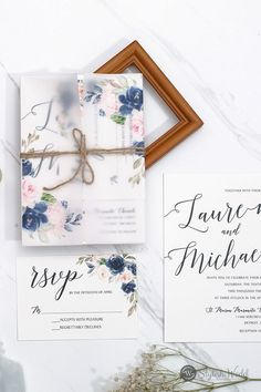 The combination of navy and blush pink is very popular for weddings in all seasons. Romance is in the air with this lovely invitation, as well as the beautiful floral backer.