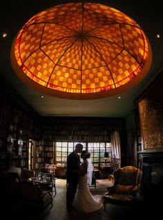The Ruins Seattle provides yet another amazing photo spot.  This time in the library with a stunning stained glass dome ceiling.  Photos by Clane Gessel Photography | #weddings #photography #brideandgroom